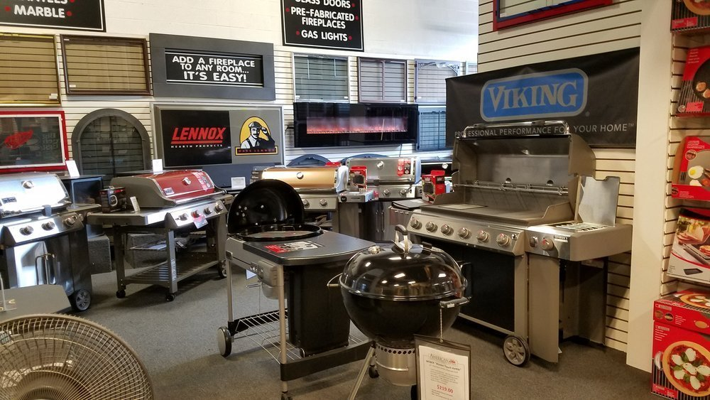 contemporary multi-colored gas grills and kettle style charcoal grills