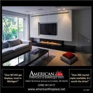 Contemporary linear Fireplace with TV and surround sound in the family room