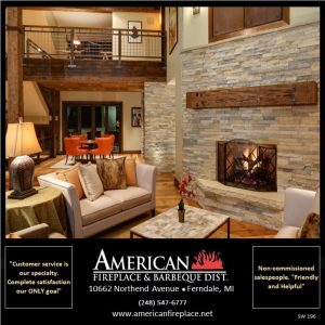 family room with Realstone walls and fireplace facade