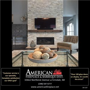 Stone fireplace facade with mantel and tv