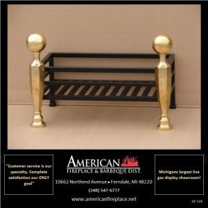 Attached polished brass andirons compliment this designer firebasket