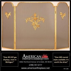 tri-fold brass Fireplace Screen with crest