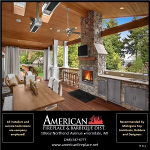 Stainless steel outdoor fireplace in outdoor kitchen with TV and outdoor infrared heaters