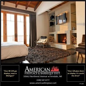 Traditional wood burning Fireplace with wall mounted tv, book cases and wood storage in the master bedroom
