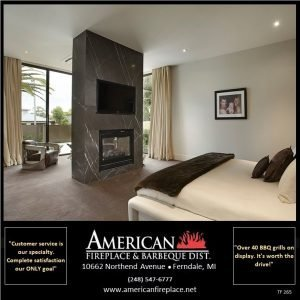 Traditional Fireplace insert with tv and marble surround in this modern bedroom