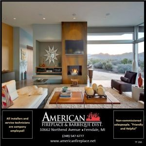Traditional see thru Fireplace with tv and  granite facade in the sun room