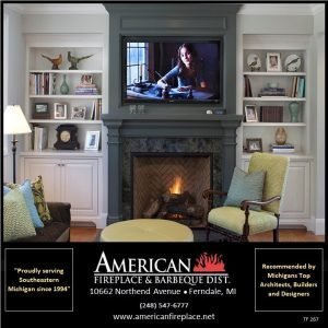 Traditional Fireplace with granite facade, painted wood mantel and surround and wall mounted tv