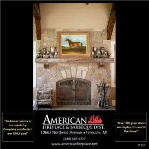 Large arched steel fireplace doors in a cultured stone traditional fireplace, walnut fireplace mantel with equestrian art and trophies